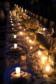 Lit Up Dining Table From An Elegant White Outdoor Dinner Party Via Karas Ideas