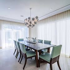 Dining Room With Modern Furniture And Lighting Sheer Long Curtains For