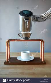 Pour Over Coffee Maker Striped Shirt With Hot Water Pouring Into A Filter