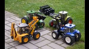 BRUDER Tractors Claas New Holland John Deere JCB 5CX Toys - YouTube Cstruction Trucks For Children Learn Colors Bruder Toys Cement Bruder Tractors Claas New Holland John Deere Jcb 5cx Toys Youtube Children 02450 Cat Rolldozer Unboxing By Jack 4 Phillips Toy Garbage Truck Video 3 Videos Children And Tonka Toys Village New Road Mack Granite Dump Truck Rc Cveionfirst Load After Man Tgs Tanker 03775 Technology Of Boys 2014 Car Timber Scania Mobilbagger 0244 Excavator Site Dump Best Of Videos