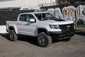 2017 Chevrolet Colorado ZR2 Rolls Out To Customers - Motor Trend Chevrolet Colorado Lifted Trucks Sca Performance Black Widow 2018 Colorado Zr2 Offroad Truck Chevrolet Chevy Near O Fallon Il New Used 2006 Chevy Crew Cab Lt 4x4 Price 16595 Miles 75264 2011 Z71 Package What A Mccluskey Automotive Lease Deals Louisville Ky 2015 Extended Cab Pricing For Sale Edmunds V6 4x4 Test Review Car And Driver Smaller Pickup Hit Plant Adds 3rd Shift To Meet Demand Undercuts The Tacoma Trd Pro 2016 Ccinnati Oh