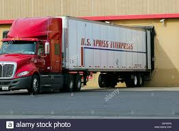 Truck Lorry Semi Tractor Trailer Backed Up To A Loading Dock Stock ... Home Nova Technology Loading Dock Equipment Installation Lifetime Warranty Tommy Gate Railgate Series Dockfriendly Mson Tnt Design The Determine Door Sizes Blue Truck At Image Scenario Cpe Rources Dock With Truck Bays In Back Of Store Stock Photo Ultimate Semi Back Up Into Safely Reverse Drive On Emsworth Ptoons And Floating Platforms Inflatable Shelter Stertil Products Freight Semi Trucks Cacola Logo Loading Or Unloading At