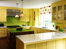 Contemporary Kitchen Cabinets In Yellow Color With Green Walls And Island Countertop