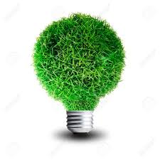 green grass growing on light bulb concept for eco friendly stock