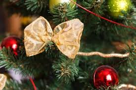 Beautiful Golden Bow And Red Green Christmas Balls On Artificial Tree Close Up Detail