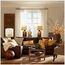 Dark Brown Sofa Living Room Ideas by Leo Zodiac Pier 1 Alluring Mirror With Red Bamboo Vases And