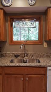 Premier Cabinet Refacing Tampa by Best Granite To Tie Together Oak Cabinets And White Appliances