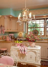 Crystal Chandelier And Under Small Carved Countertop Kitchen Island White Wooden Cabinet Also