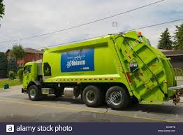 Green Garbage And Recycling Truck On Pick Up Day On A Street In ... Debary Trucks Used Truck Dealer Miami Orlando Florida Panama Hino Trucks Used Hino Truck Fancing Green Garbage And Recycling On Pick Up Day A Street In New Cars Suvs Toronto On Carpagesca The History Of The Ice Cream Semi For Sales Arrow Am General Diesel 6 Wheel Drive Army Winches 360 Degree Rontotruckjpg City Centre Airport Canada Fire