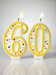 numbered birthday candles aflame shot on white background