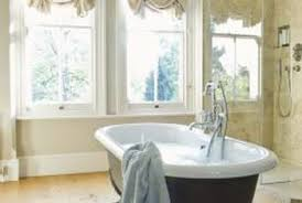 Installing Laminate Floors On Walls by How To Install Laminate Floors Under A Cast Iron Tub Home Guides