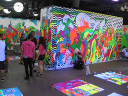 People Look At The Colorfully Painted Walls Or Take Up A Brush And Contribute With