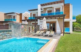 Ornos Beach With Typical White Aegean Cube Houses Mykonos Greece
