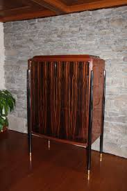 Armoire Art Deco. Armoire Art Deco With Armoire Art Deco. Cool ... Studio Twenty Two French Art Deco Armoire Beautiful Walnut Tallboy Compactum Compact Small Antique Bedroom Fniture Interior Design Art Nouveau Essay Symbolism Heilbrunn Timeline Of Grande Coiffeuse Loupe D Orme Moderniste Ancien Cool Waterfall Style Chifferobe Attainable Dressers Chests And Storage World Market Set Bed Nightstands 1 A Crotch Mahogany Cabinet From France At Armoires Deco This Armoire Is Featured In Solid Wood With Glossy