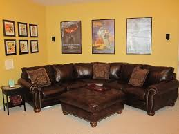 Brown Leather Couch Living Room Ideas by Yellow Wall Color With Elegant Ottoman Coffee Table For Bright