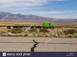 100 Crowley Trucking A Big Rig Truck Traveling South On Highway 395 With Lake
