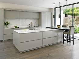 Sleek Handleless Kitchen Design With Large Island Breakfast Bar Marble Splashback And Floor To