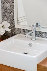 powder room with gray herringbone tiles transitional bathroom