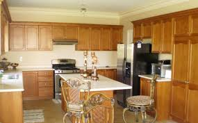 Kitchen Elegant Black Granite Countertop Oak Cabinet Stained Wood Cabinets Lovely White Painted Finish Excellent Decorating