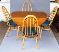 Ercol, A Vintage Blonde Drop Leaf Dining Table And Four Quaker ... Blonde Woman In Black Kitchen Ding Room Side Stock Image Art Deco Table Plus 4 Matching Chairs 509692 Ball And Claw Pladelphia Chair Kennedy Ding Suite With Benson Chairs Focus On Fniture Drexel Heritage Compatibles Wood Set Four City Brewing Publicans Gathering W Lager Alf Italy Modern Chairish Stunning Retro Ercol Vintage Light Brooklyn Home Tour Style Drop Leaf Quaker Back Mcm Blonde Splayed Leg Table 5 Picked 54 Round Elegant Pine Center Or Intended