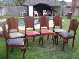 SOLID IMBUIA DINING ROOM TABLE AND CHAIRS BALL CLAW Pretoria