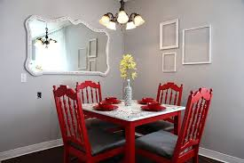 An Infusion Of Red For The Dining Room With Empty Frames On Wall