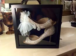 what a great idea placing your wedding shoes in a shadow box