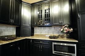 kitchen cabinets with white backsplash light granite grey