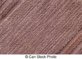 Light Brown Background Of A Knitted Textile Material Fabric With Striped Texture Closeup
