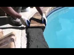 installing brick coping on a swimming pool