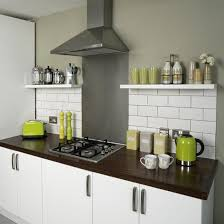 Metro Style Kitchen Tiles White Units And Dark Wood Top Then Colourful Accents In Accessories