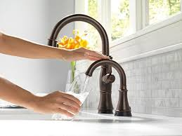 Delta Touchless Faucet Design With Double Curved Necks For Kitchen Decoration Using Rustic Style