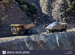 Large Mine Dump Trucks In Kennecott Copper Mine In Central Utah ... Belaz 75710 The Giant Dump Truck Hardy Services Size Comparison Of A Car The Largest Dump Truck And Workers Pass By One World Biggest Pictures Getty Images S Werelds Grootste Trekker Industrial Tyres Amsterdam Cath In Canada Biggest In 450ton Has Been Entered Guinness Book World Belaz Worlds Skyscrapercity Volvo Ce Unveils 60ton A60h Articulated Equipment Belaz Presents Scania Heavy Tipper For Higher Payloads Group Komatsu 830e 10 Trucks Claims Largest Title Trend