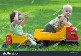 Two Kids Playing Toy Trucks Park Stock Photo (Edit Now) 34958668 ...