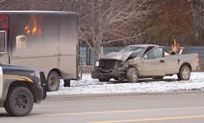Two Injured After UPS Truck, Pickup Collide On Grand River Avenue