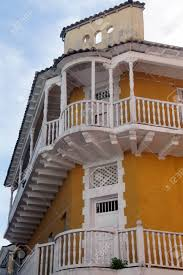 100 Ochre Home Yellow Ochre Colonial Building With White Balconies In Old Town