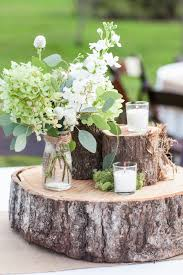 Rustic Farm Wedding Tree Trunk Centerpieces Candles Moss Flowers Table CenterpiecesSpring