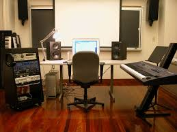 Great Looking Home Music Studio Design With White Computer Desk Table And Laminated Wooden Floor