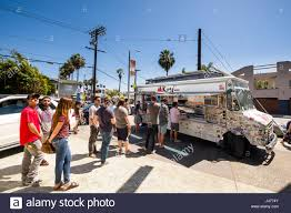 People Standing In Line To Order Take-away Lunch A Mobile Food Truck ... La And The Food Truck Totally Nissan Steals Attention And Feeds The Press At 2011 Los Angeles Auto Best Trucks In Travel Leisure Le Croissant Roaming Hunger Nomad La Carte Dessert Tour Sweet Side Of Spitz Street Eats Pinterest Truck Best Food Trucks Angeles Where Do Go At Night Sugo Traditional Italian Flavour Wrap Piaggio Gaucho On Wheels Vehicle Wraps 1