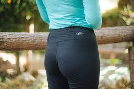 A Woman Wearing Our Pick For Best Base Layer Bottom Facing Away From The Camera