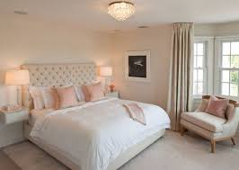 Pale Pink Walls With Light Upholstered Headboard