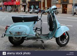 Old Vespa Scooter Parked In Barcelona Street