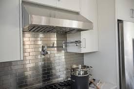 stainless steel mini brick tile backsplash kitchen moen swing arm