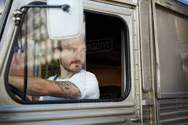 Young Man Looking Out The Window While Driving Food Truck In City ... Woman Truck Driver Looking Out The Door Of A Big Rig From Stock Driver Shortage In Industry Baku Experience Life Trucker Truck On Xbox One Looking In Sideview Mirror Photo Getty Images Military Veteran Driving Jobs Cypress Lines Inc Owner Operator Application Are You For Traing Brisbane We Are Good Garbage Waste Management Trains Senior Throw The Window Picture Male Out Of Image Forwarding Sits Cab His Orange Edit Now 18293614 Guy Pickup At Shotgun Video Footage Videoblocks