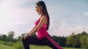 Fitness Woman Stretching Legs In Park At Sunny Day Asian