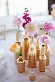 si e de table gold centerpiece gold spray painted bottles wedding centerpiece