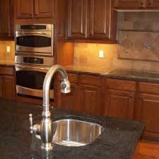 kitchen granite countertops omaha with tile backsplash also
