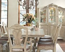 ortanique rectangular double pedestal dining room set by ashley
