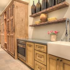 Reclaimed Barn Wood Floating Shelves Over Rustic Kitchen Cabinet