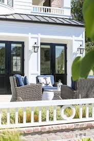 Beautiful Patio With Wicker Furniture Navy Blue Cushions To Coordinate The Anchor Pillows Patterson Custom Homes